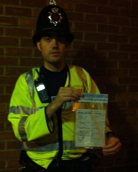 Sergeant Tim Scott with the half gram bag of cocaine found on the floor in the Temeraire.