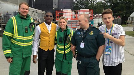 Ambulance staff with performers Labrinth and Conor Maynard at V Festival.