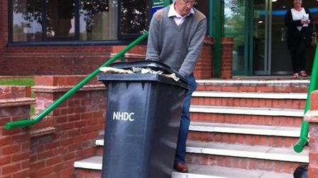 Mike Percy taking the bin into the council offices in Letchworth GC on Friday
