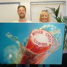 Sarah Graham and Ricky Wilson from British band Kaiser Chiefs with Sarah's painting
