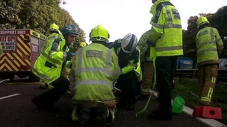 Paramedics take over after firefighters used cutting equipment to free a man from his car. Credit: E