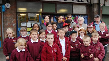 Club leaders and children outside the youth club