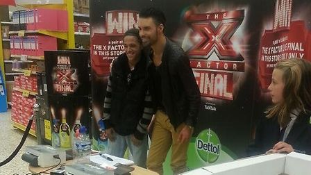 Rylan poses with a fan at Stevenage's Tesco