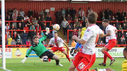 Joe Murphy makes a good save from Jon Ashton after a well worked free kick routine. Photo by Danny L