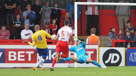 Leon Clarke scores past Chris Day at his near post. Photo: Danny Loo