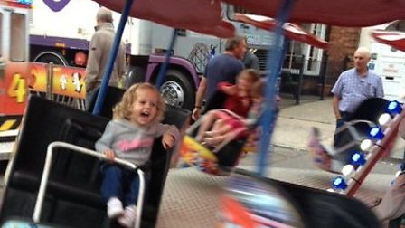 Two-year-old Isabelle Headland enjoying the fair in Stevenage High Street