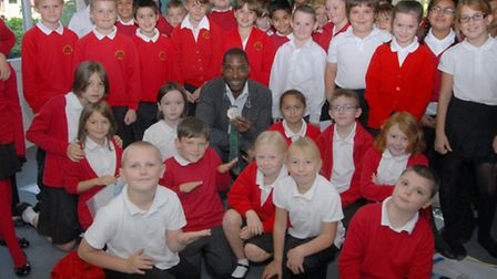 Mark Richardson with his silver medal and pupils