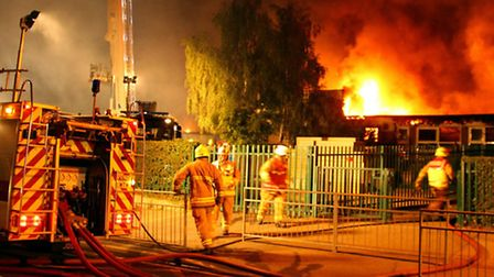 Firefighters battle the blaze at John Ray County Infants School on August 31. Picture: Stephen Huntl