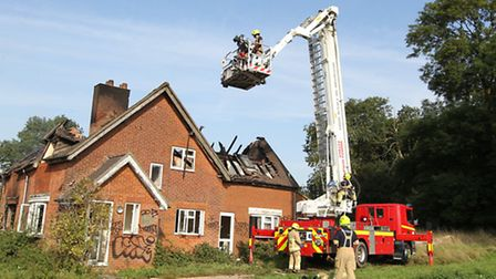 Firefighters at the scene of the house fire on Clothall Road