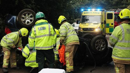 Emergency services work to free the woman following a crash in Rectory Lane, Stevenage. Credit: East