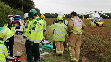 The air ambulance lands at the scene of the crash on Grange Road in which a Saffron Walden man later