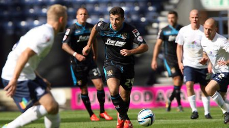 Michael Doughty looks for a pass. Photo: Stuart Bogg Imaging