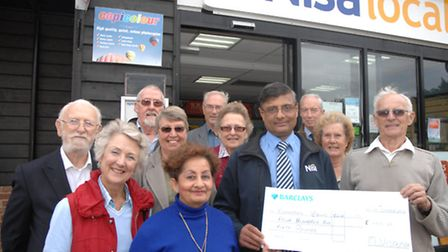 Members of Clavering Bowls Club receive the cheque from the village's Nisa Local store.