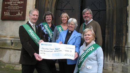 St Mary's Church Revd Paula Griffiths presents a cheque to Richard Luckes, chairman of the Saffron W