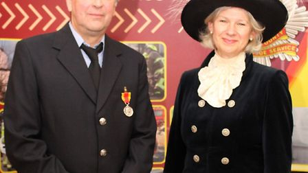Brian Foster was presented with his long service medals by the High Sheriff of Essex, Julia Abel Smi