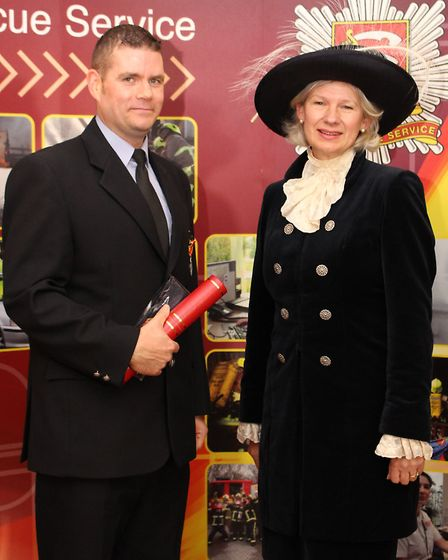Phillip Wright was presented with his long service medals by the High Sheriff of Essex, Julia Abel S