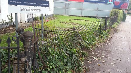Damaged gate outside the Thomas Alleyne Academy following an accident