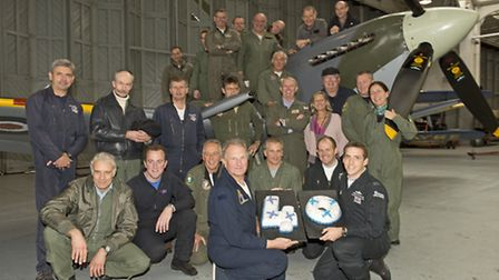 Pilots from across the years at IWM Duxford pose for a commemorative photograph with Supermarine Spi