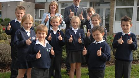 Headteacher Rachel Callaghan and deputy head Anthony Hull, and the School Council, celebrate the sch