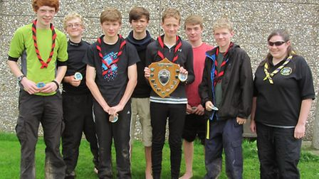 Winners of the explorer scout section, Andre's Boys, being presented their shield and badges by Hele