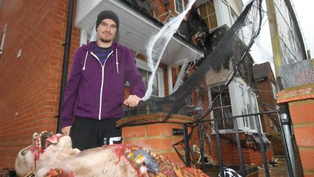 James Creighton has been told by police to tone down his Halloween decorations outside his house in