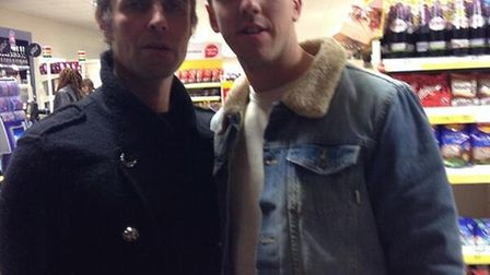 Liam Gallagher poses with fan Max Robson