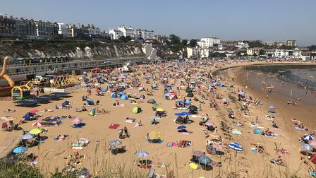 People flock to Broadstairs beach in Kent to enjoy the weather, as the UK has surpassed the hottest