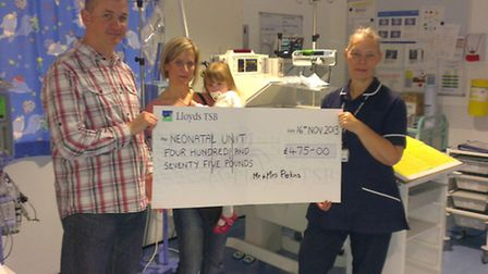 Matthew Wendy and Freya-May Perkins present their cheque to Helen Smith from the neonatal unit at Li
