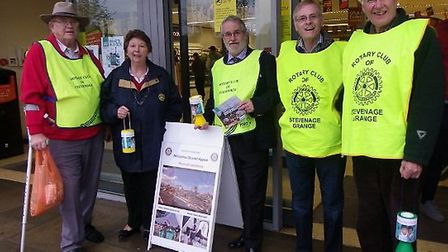 Richard Dixon, president of the Rotary Club of Stevenage, Prue Dixon and Alex Lang, members of the R