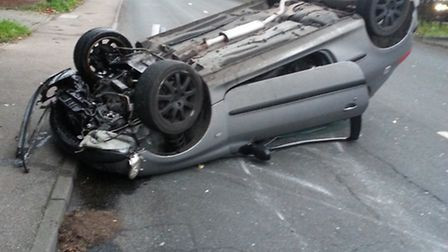 The overturned car in Hitchin Road, Stevenage