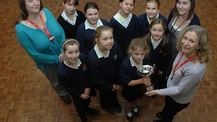 Jill Palmer (front right), hands the trophy over to Sydney Kelly, 10, and other Year 6 pupils, with