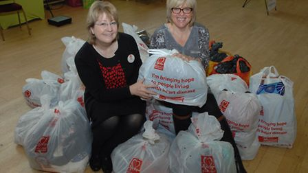 Jean Smith (manager, BHF Saffron Walden shop) and Debbie Crawte (Weight Watchers leader) sitting on