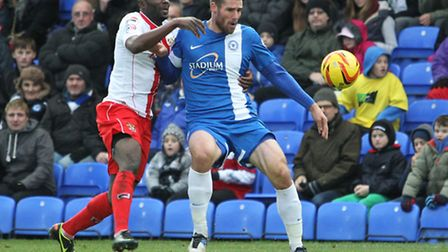 Former boro player Michael Bostwick holds off Francois Zoko. Photo: Danny Loo