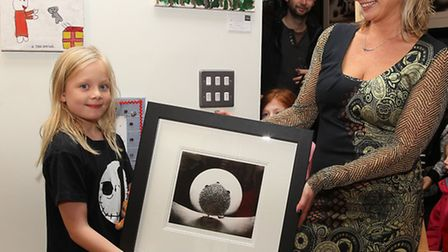 Gallery owner Hayley Norman presents Emily Rogers with her first prize