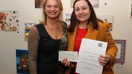 Gallery owner Hayley Norman presents Lucy Aldridge from William Ransom Primary School with the prize