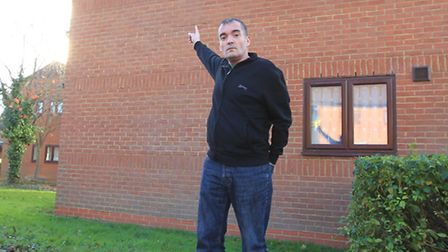 Andy Knight points to one of the lights he has unknowingly been paying for