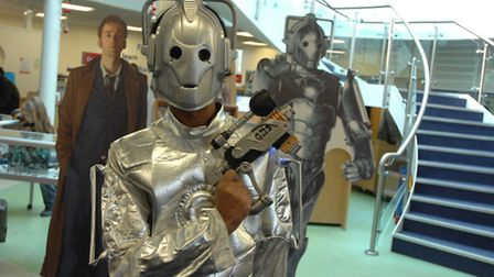 Krishna dressed as a Cyberman as part of Saffron Walden Library's Dr Who exhibition