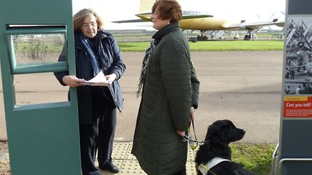 A member of the Historic Duxford access panel tests out the heritage trail interpretation with Kay C