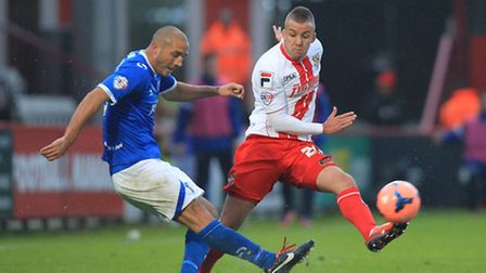 Jimmy Smith of Stevenage makes a tackle