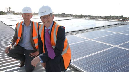 From left, Rob Flynn, managing director at Solarbarn Ltd, and Communities Minister Don Foster, MP fo