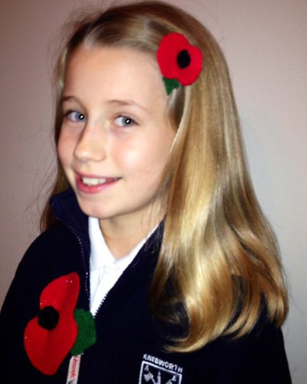 Jessica Bedford with two of her poppies