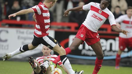 Lucas Akins tries to hook the ball away from Doncaster during the 2012/13 season. Photo: Harry Hubba