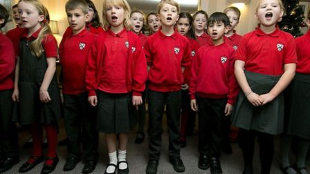 Puils of St Thomas More School visited residents and sang Christmas carols
