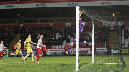 Sheffield United keeper George Long tips over a cross from Tansey which was dipping in
