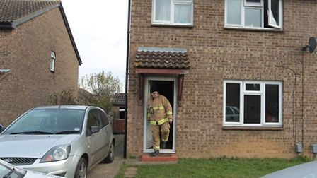 A fireman a the scene of a house fire in Coleridge Close, Hitchin, where four people had to be taken