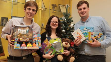 Comet reporters, Martin Dunne, Louise McEvoy and James Scott, with donated toys for the Keech Hospic