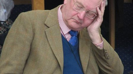 Pictures appearing to show Cllr John Davey nodding off during an Uttlesford District Council plannin