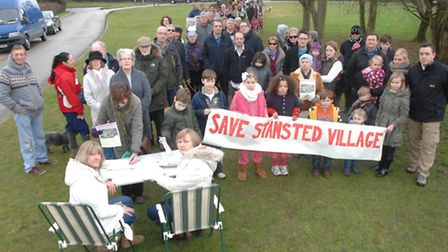 Residents in Stansted lined up to sign a petition opposing the 140-home development earmarked for th