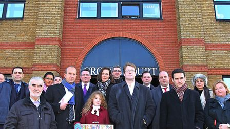 Barristers on strike stand on the steps of St Albans Crown Court on Monday