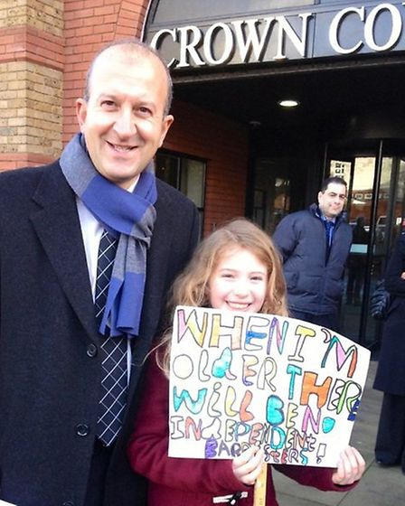 Kerim Kerim Fuad QC, chairman of the Hertfordshire & Bedfordshire Bar Mess, with a young protestor